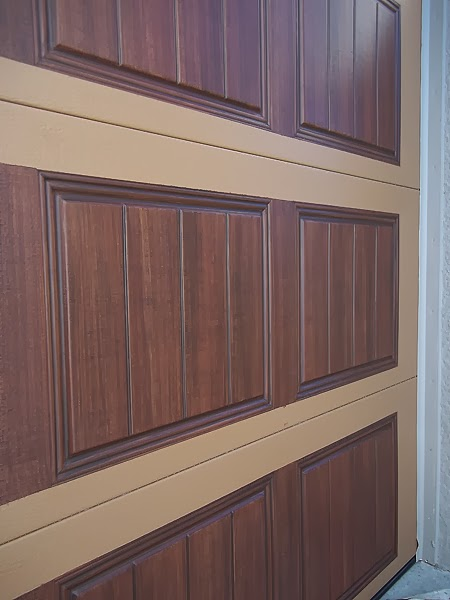 detail of a garage door painted like wood