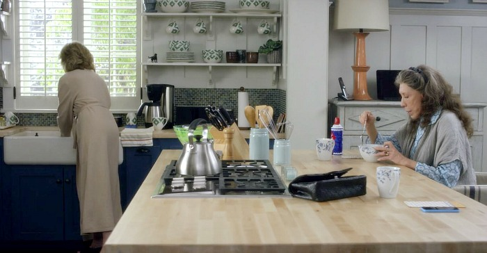 Grace and Frankie beach house kitchen with blue cabinets and farm sink. Come check out 15 Grace and Frankie Beach House Decorating Ideas! #graceandfrankie