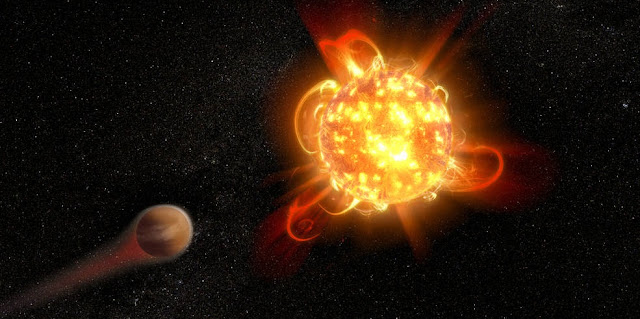 Violent outbursts of seething gas from young red dwarf stars may make conditions uninhabitable on fledgling planets. In this artist's rendering, an active, young red dwarf (right) is stripping the atmosphere from an orbiting planet (left). Scientists found that flares from the youngest red dwarfs they surveyed — approximately 40 million years old — are 100 to 1,000 times more energetic than when the stars are older. They also detected one of the most intense stellar flares ever observed in ultraviolet light — more energetic than the most powerful flare ever recorded from our Sun. Credits: NASA, ESA and D. Player (STScI)