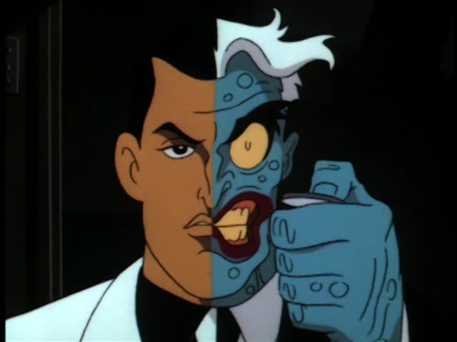 a picture of Two-Face, holding their signature coin.