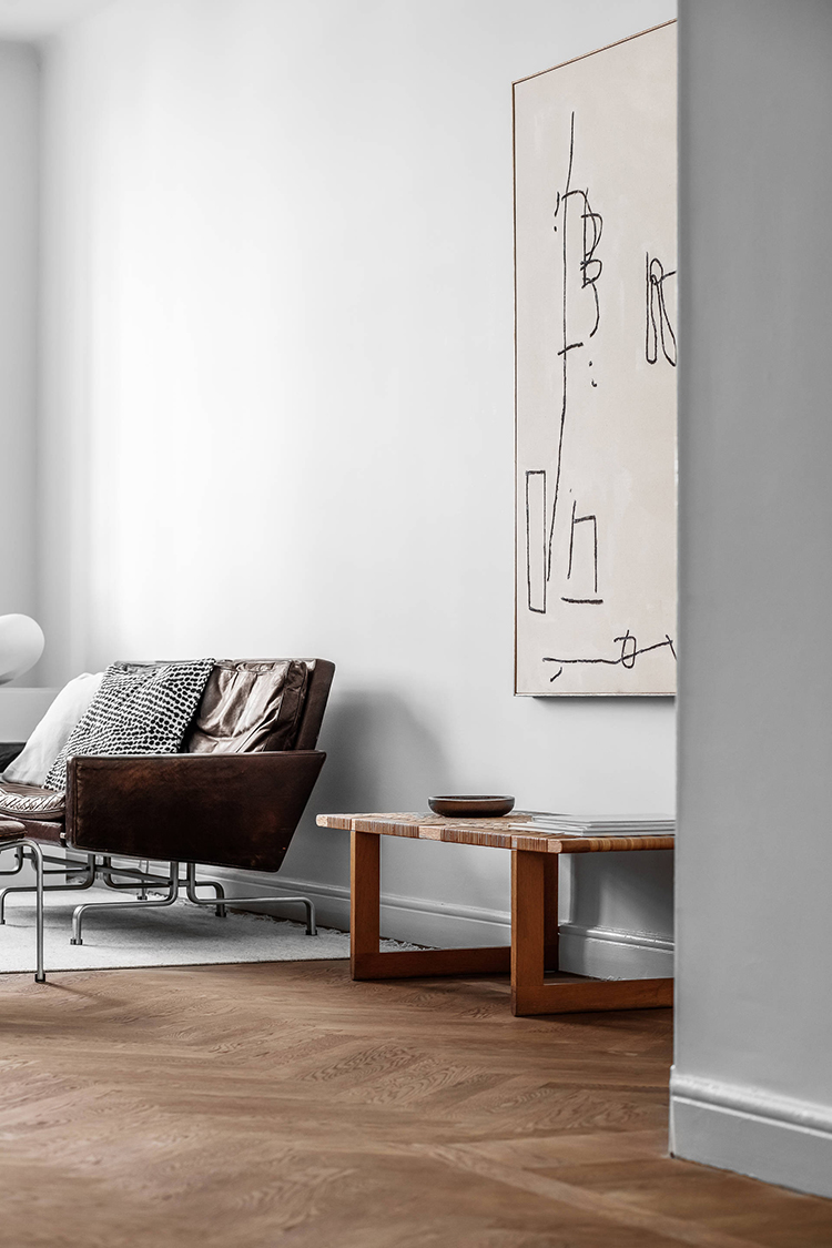 Contemporary scandinavian apartment with large scale art. Image via Behrer and Partners