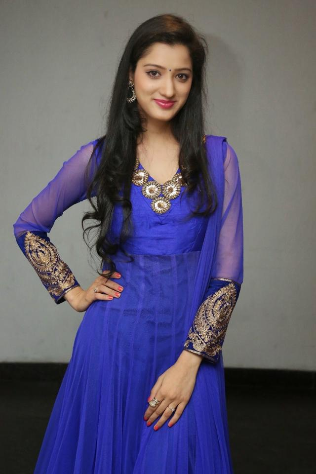 Telugu Actress Richa Panai Long Hair Stills In Blue Dress