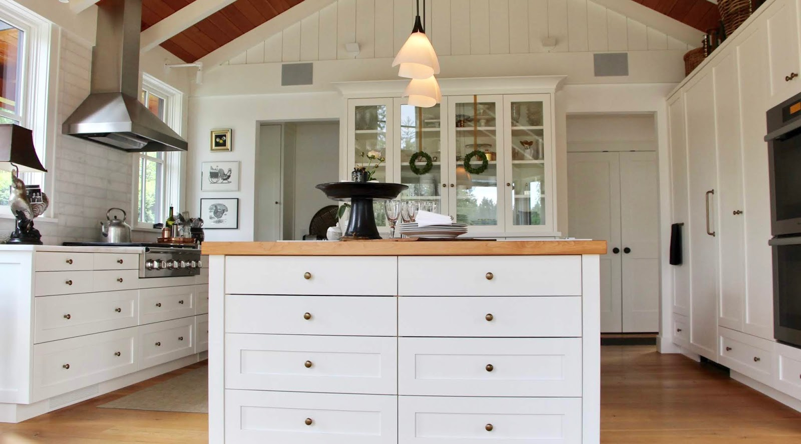 92cf6e6c0ef The little boxwood wreaths add just the right amount of color to this all  white kitchen.