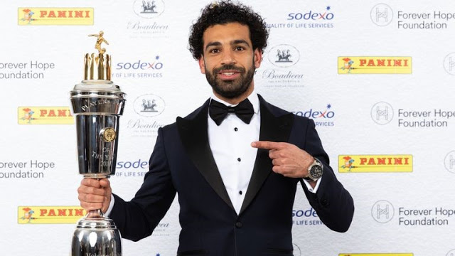 Mo Salah holding his PFA player of the year trophy