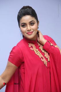 Actress Poorna Latest Stills in Red Dress at Rakshasi First Look Launch  0160.JPG