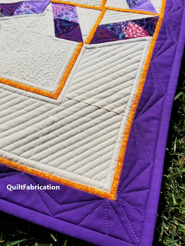 one fourth inch 45 degree lines in the quilt corner
