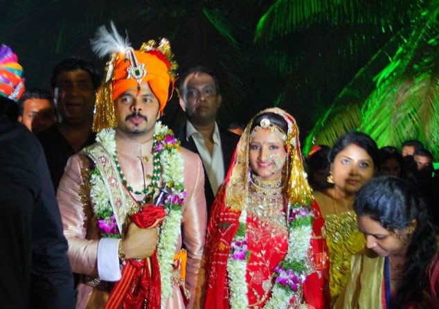 Sreesanth and Bhuvneshwari as groom and bride in their wedding photo