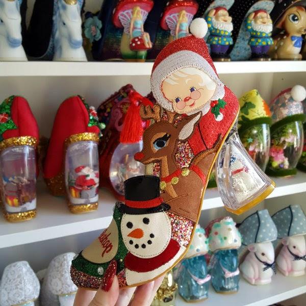 snowman festive character shoe in front of irregular choice shoe shelves