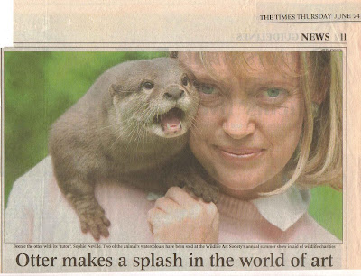 Sophie Neville with her otter in The Times