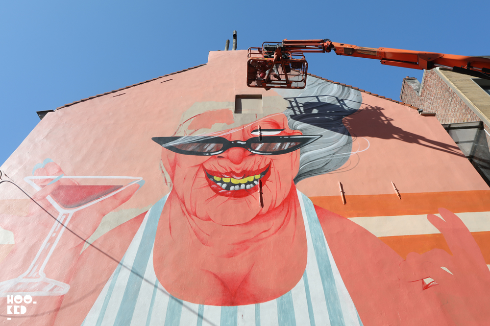 Marina Capdevila at work on her mural in Ostend, Belgium