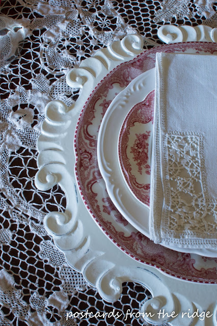 Red transferware and vintage linens. Johnson Brothers Britain Castles.