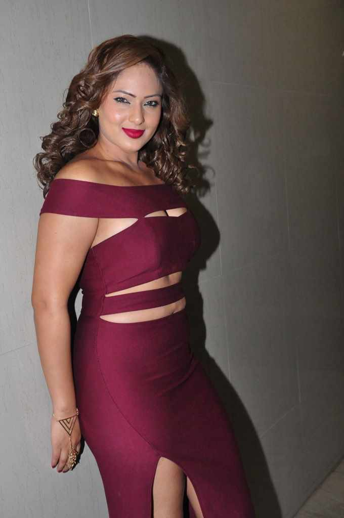 Actress Nikesha Patel Hot Sizzling At Audio Launch In Maroon Dress