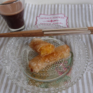 https://danslacuisinedhilary.blogspot.com/2015/09/nems-ananas-caramelise-sauce-chocolat.html