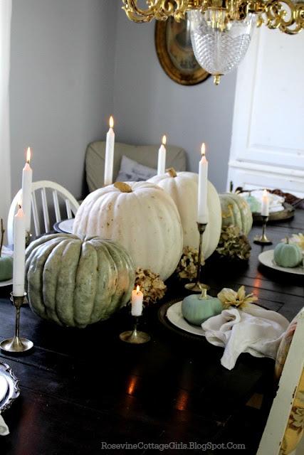 Photo of a black wooden table set for thanksgiving dinner | rosevinecottagegirls.com
