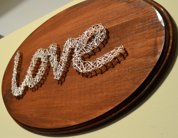 This DIY string art sign is easy and fun to create.