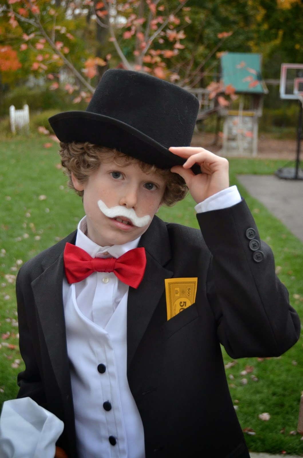 this year the childrens costumes were half put together from the thrift store and half made by grandma harris was uncle pennybags the monopoly man from