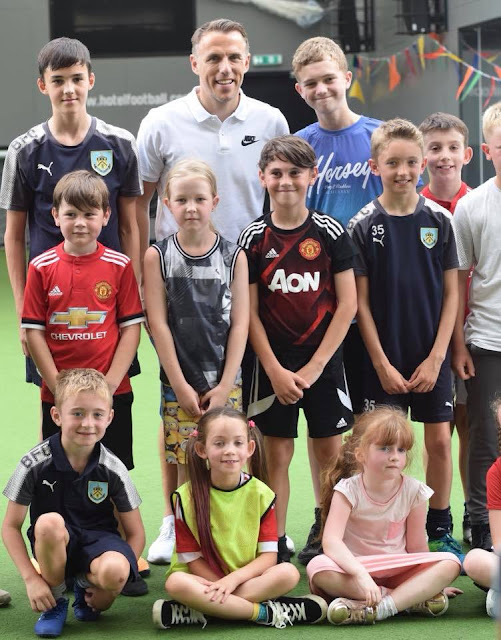 Gary Neville and kids in football kids