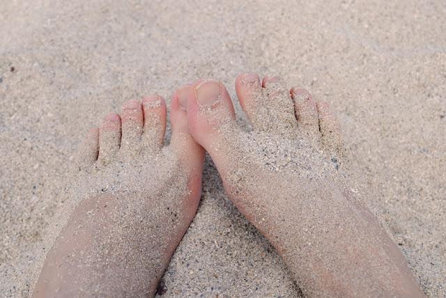 voeten zand