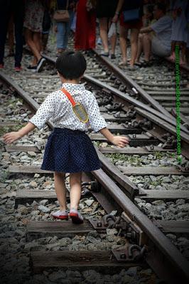 child walking on Rail lines, Tanjong Pagar Raiway Station, Singapore