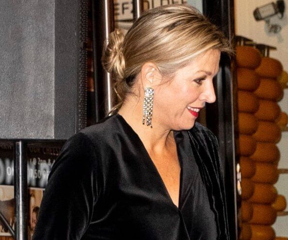 Queen Maxima wore a velvet top and metallic trousers as she joins husband at a film premiere in Amsterdam