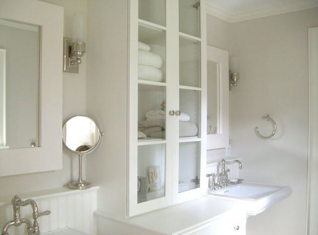 white small bath with storage medicine cabinets pedestal sinks