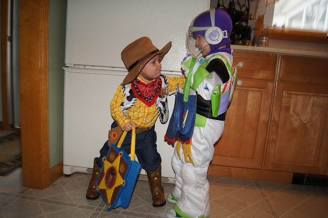Buzz pushing Woody