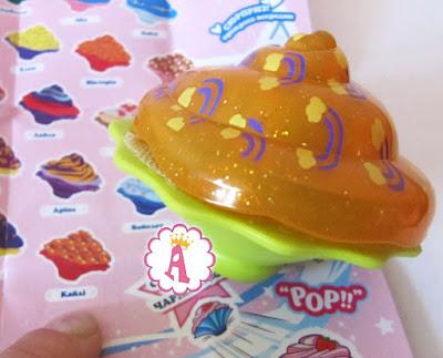 Кукла поп-кейк Кайли с оранжевой шляпкой в радуги