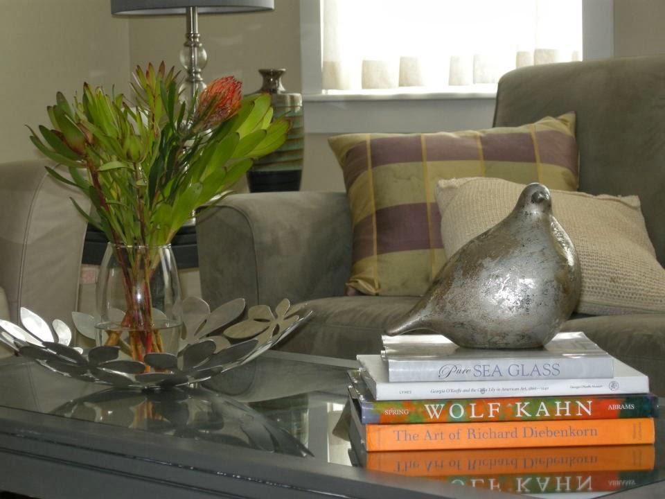 mercury bird vignette living room books coffee table