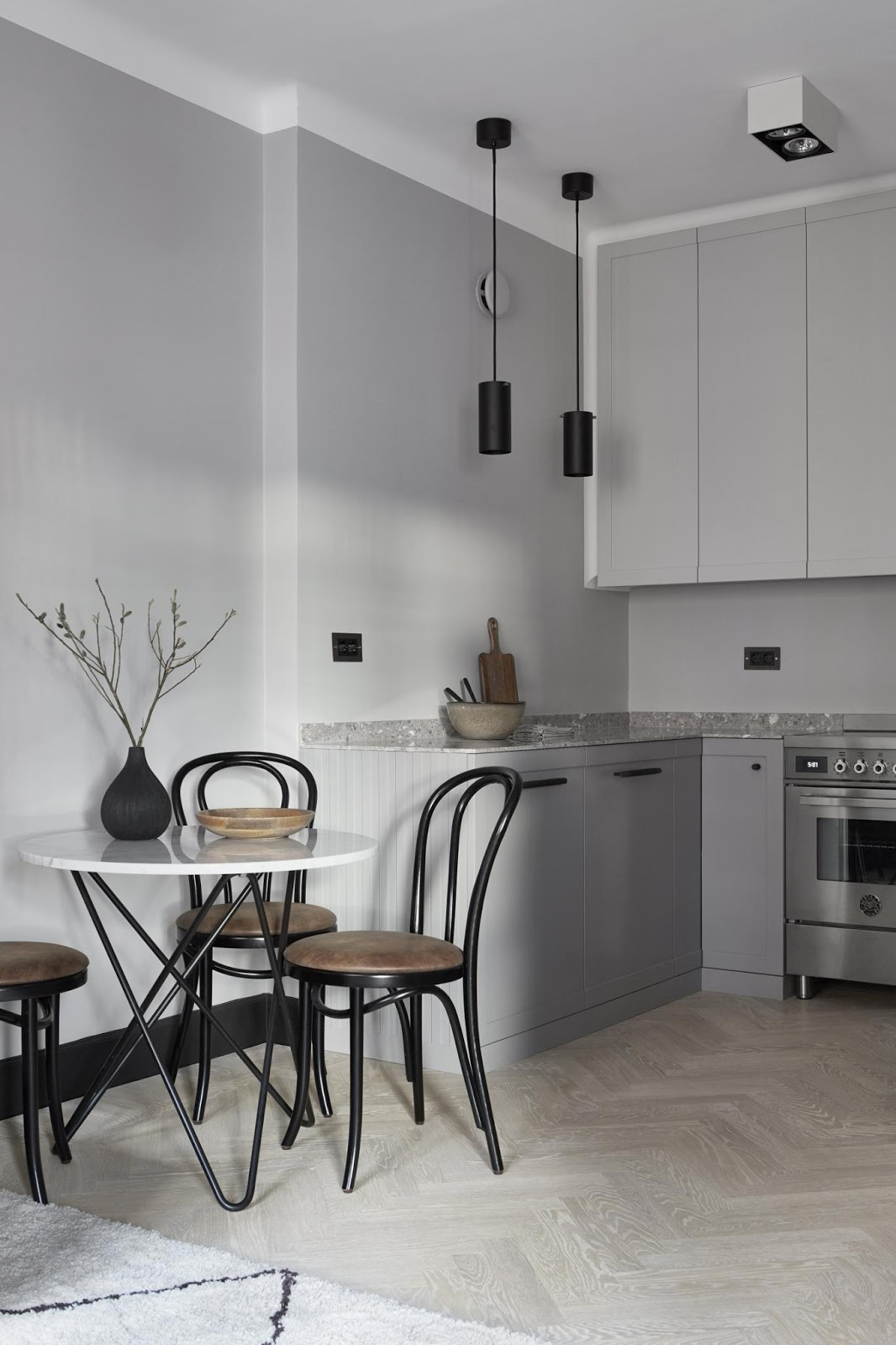 This Kitchen In A Swedish Flat Has Been Finished In Multiple Shades Of  Grey. The Worktop, Upper Cabinets, Lowers And Steel Appliances Give  Multifaceted ...