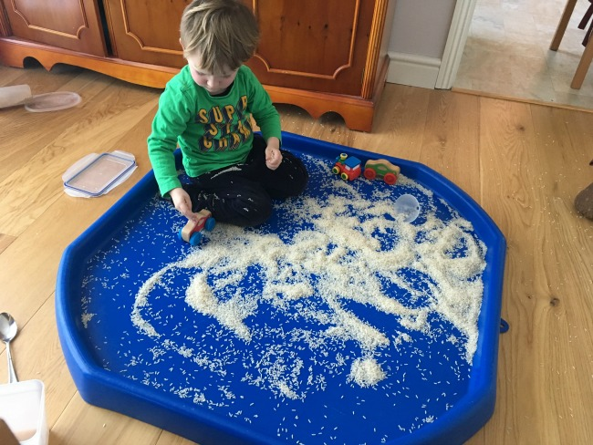 5-minute-games-for-toddlers-not-so-messy-play-toddler-playing-with-rice
