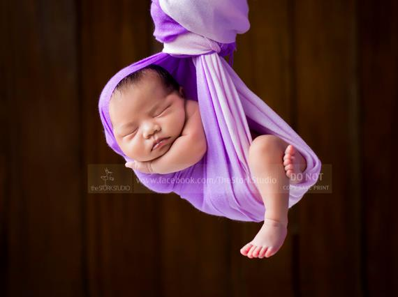 Bouncing behind the lens newborn photographer manila zhen is the word of the day