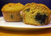 Homemade white whole wheat blueberry muffins on a plate