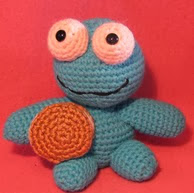 http://www.ravelry.com/patterns/library/crocheted-cookie-monster-lookalike-amigurumi