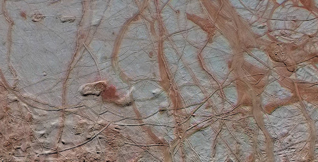 This enhanced-color view from NASA's Galileo spacecraft shows an intricate pattern of linear fractures on the icy surface of Jupiter's moon Europa. Credits: NASA/JPL-Caltech/ SETI Institute