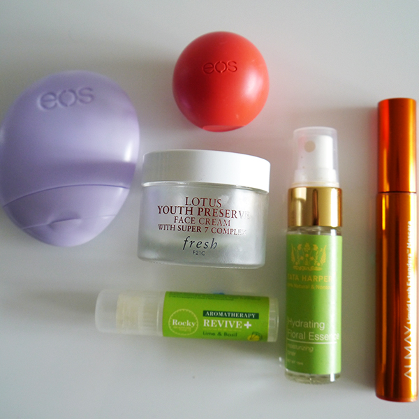 EOS lip balm and hand lotion, Tata Harper Hydrating Floral Essence travel size, Almay Liquid Lash Extenders Mascara, Rocky Mountain Soap Co. Aromatherapy Stick in Revive Lime & Basil, Fresh Lotus Youth Preserve Face Cream with Super 7 Complex
