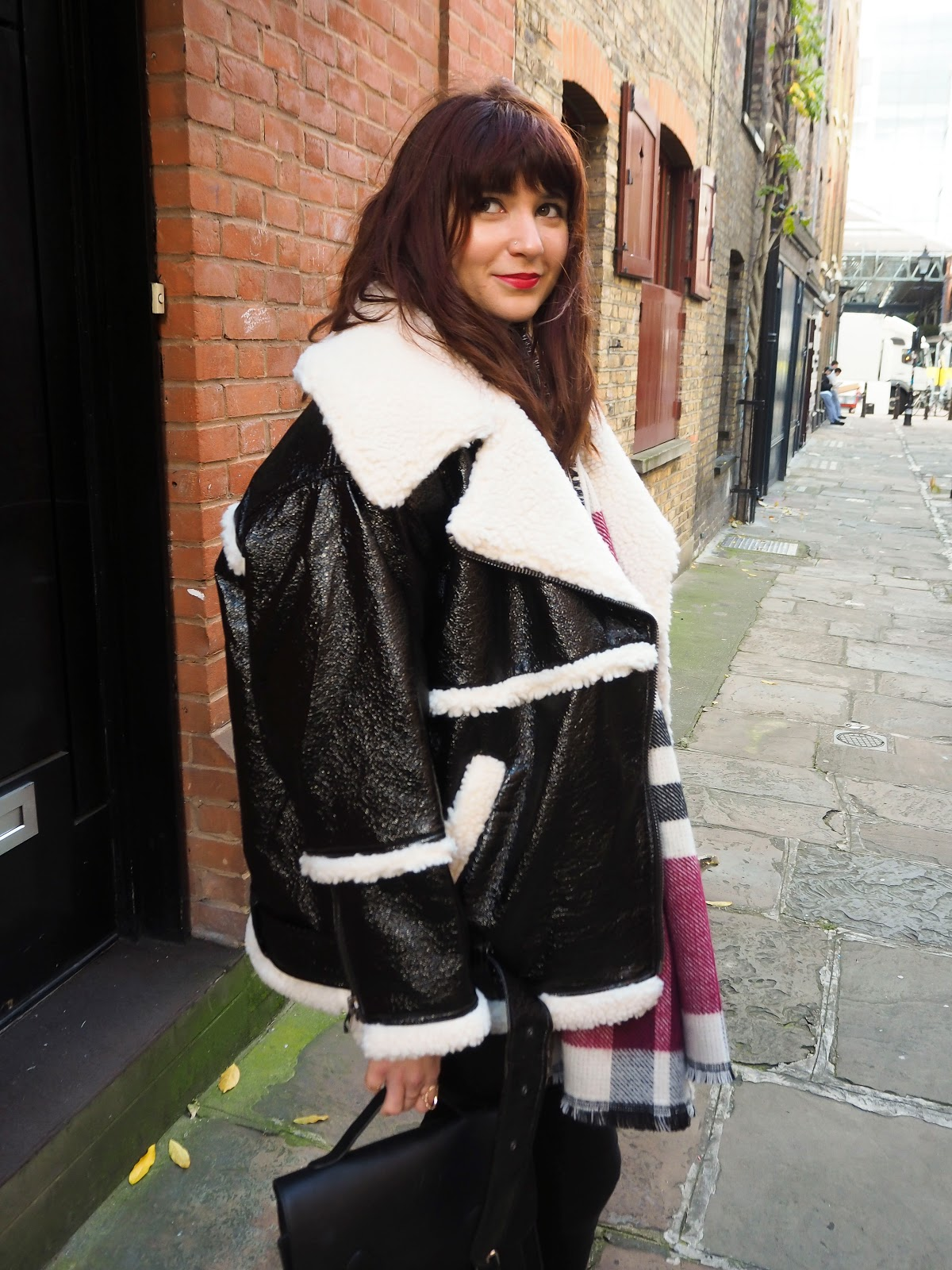 Monki-ing around in this patent and shearling coat