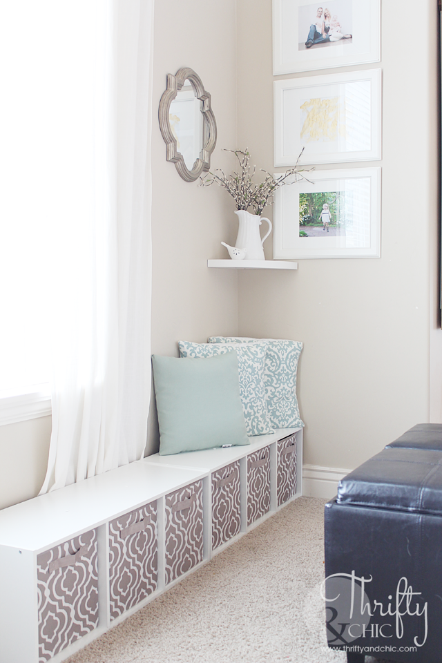Hide a cute play area in your living room without it looking like a mess! Place it behind a sofa out of sight.