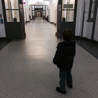 Boy with autism in empty hospital corridor