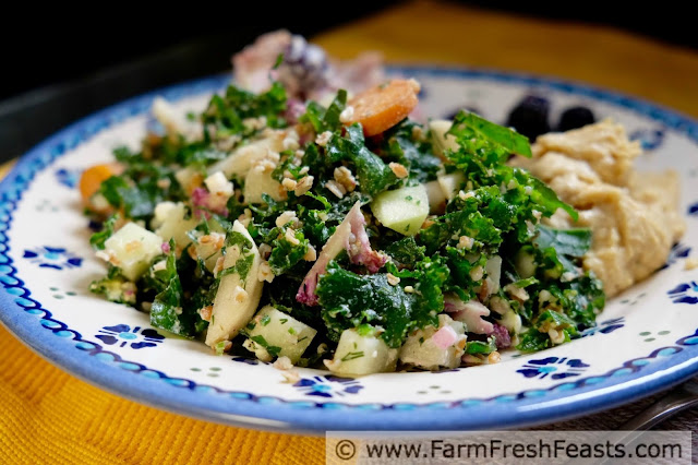 a plate of CSA farm share chopped salad with kale, purple cauliflower, kohlrabi, Hakurei turnips, bulgur, eggs and feta