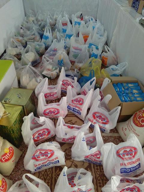 Τρόφιμα για άπορες οικογένειες από τον Ιερό Ναό της Ευαγελίστριας Ναυπλίου
