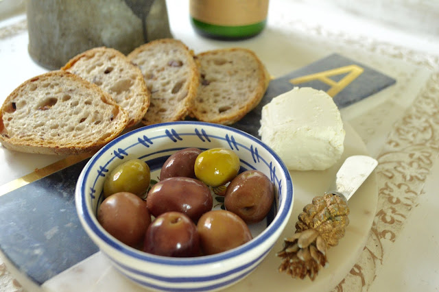 Peplums & Pie: Honey Goat Cheese and Greek Olive Baguette // Anthropologie marble monogram cheese board // greek olives //peplumsandpie.com