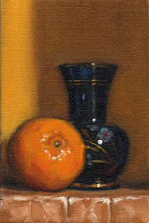 Oil painting of a mandarine beside a small glass vase painted with flowers.
