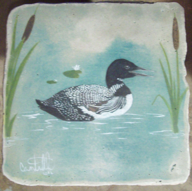 Loons on a concrete Tablel Top