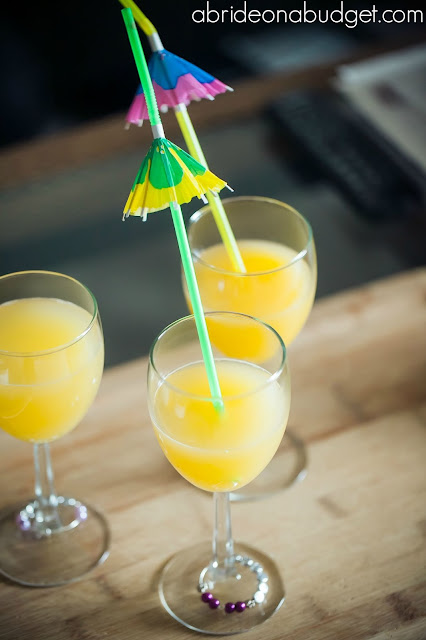 Start your wedding morning off right with a Morning Mimosa Bar. Find out how at www.abrideonabudget.com.