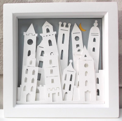 papercut picture of leaning towers