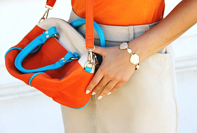 Mexx beige mini skirt.Orange knitted top.Color block orange and beige bag.Cream bracelet.White H&M nail polish.