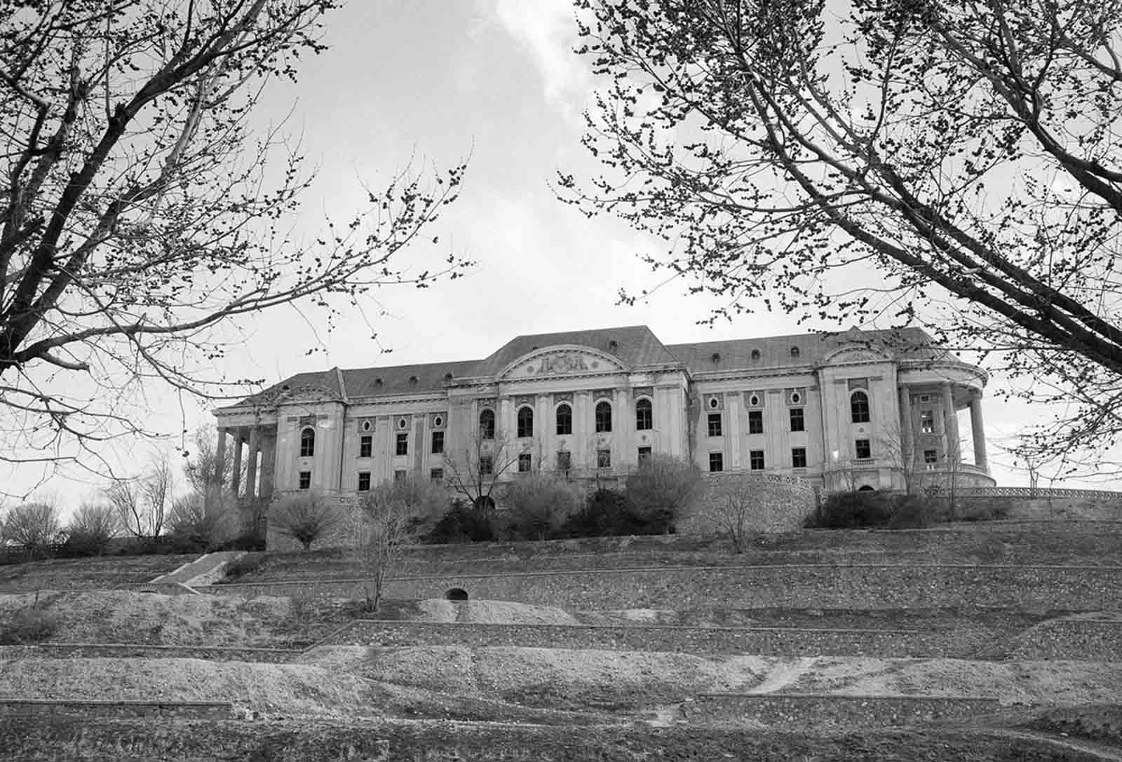 Tajbeg (Queen's) Palace, the Palace of Amanullah Khan in Kabul, photographed on October 8, 1949. Amanullah Khan, King of Afghanistan in the early 20th century, attempted to modernize his country and make many reforms to eliminate many age-old customs and habits. His ambitious plans and ideas were based on what he had seen during a visit to Europe.