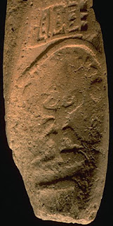 Harappan terracotta tablet H2000-4441, showing the horned deity seated on a stool under an arch