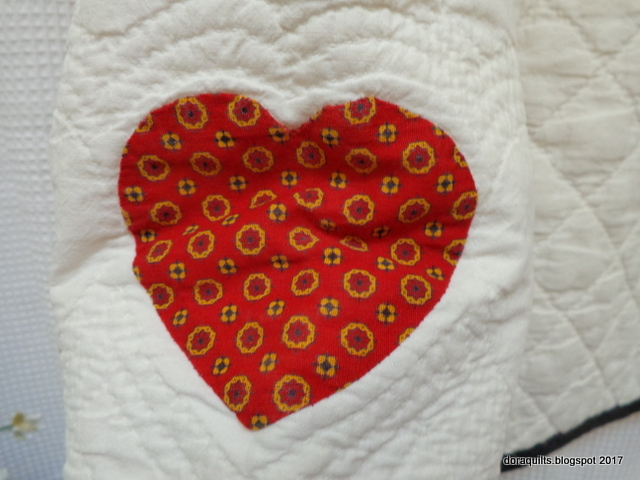 Each sleeve was adorned with one applique heart plus two quilted ones