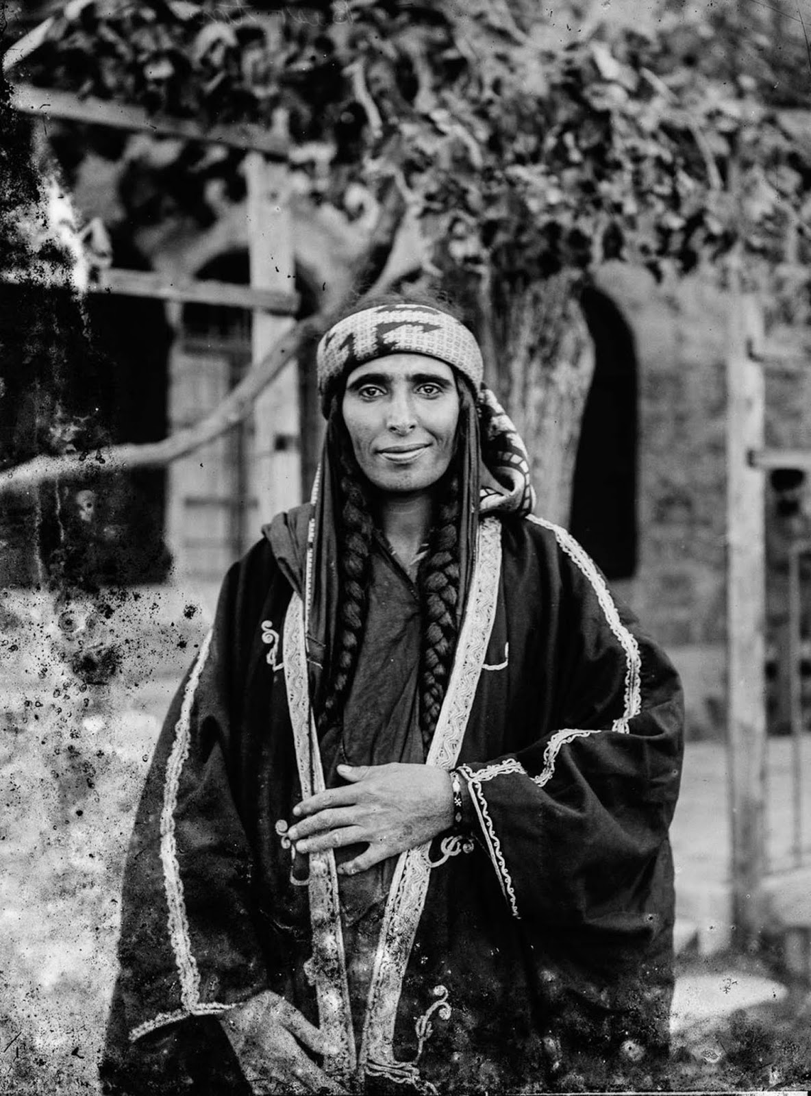 Arab Christian Bedouin woman from the settled town of Kerak, Jordan, who probably was the wife of a sheikh. Braids were predominantly worn by Arab Christian Bedouin women of the tribes of Jordan.